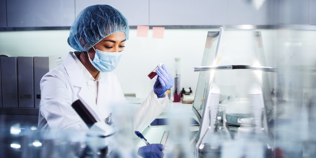 Young female doctor working in a lab