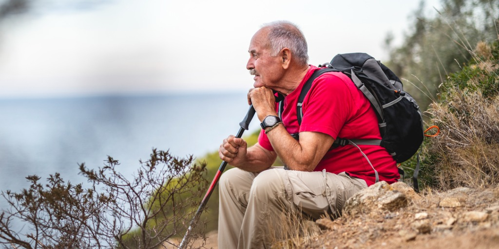 Contemplative senior man taking a break from his hike.