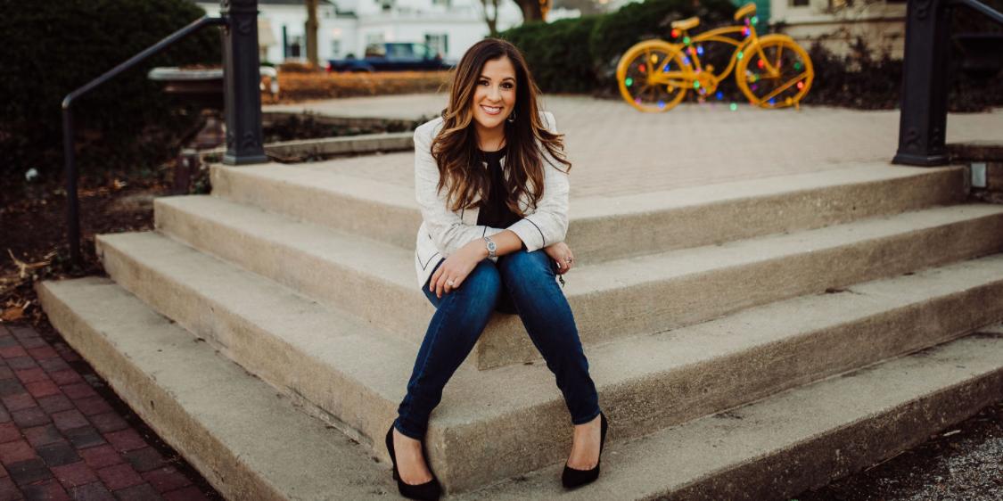 Courtney Wulf sitting on steps outside