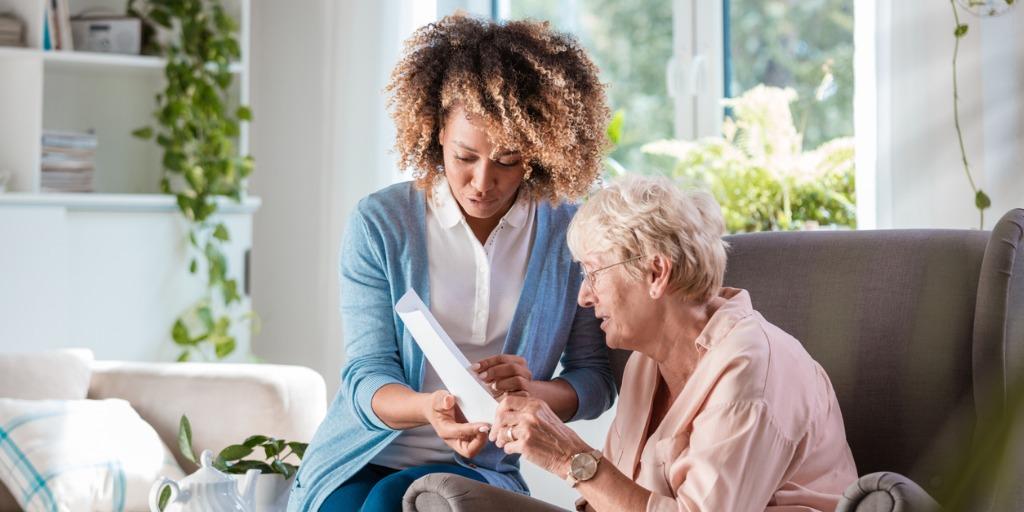 Home nurse taking care of elderly woman