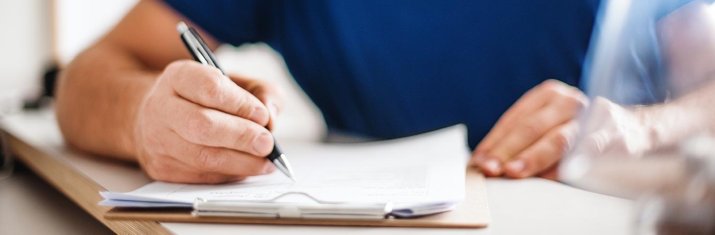 hand-pen-writing-notebook.jpg