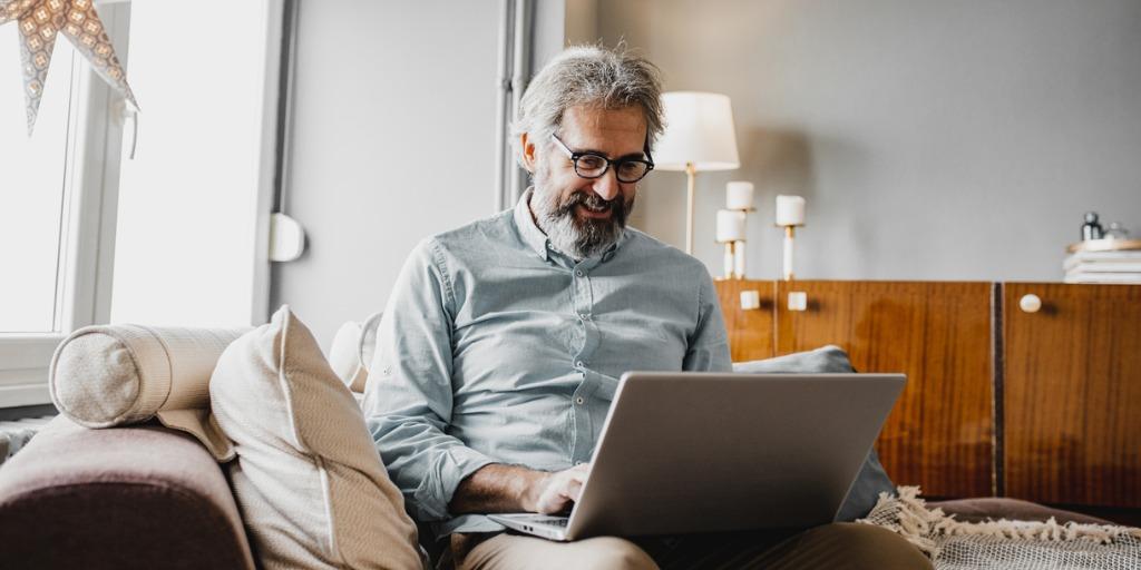 Man using laptop in living room