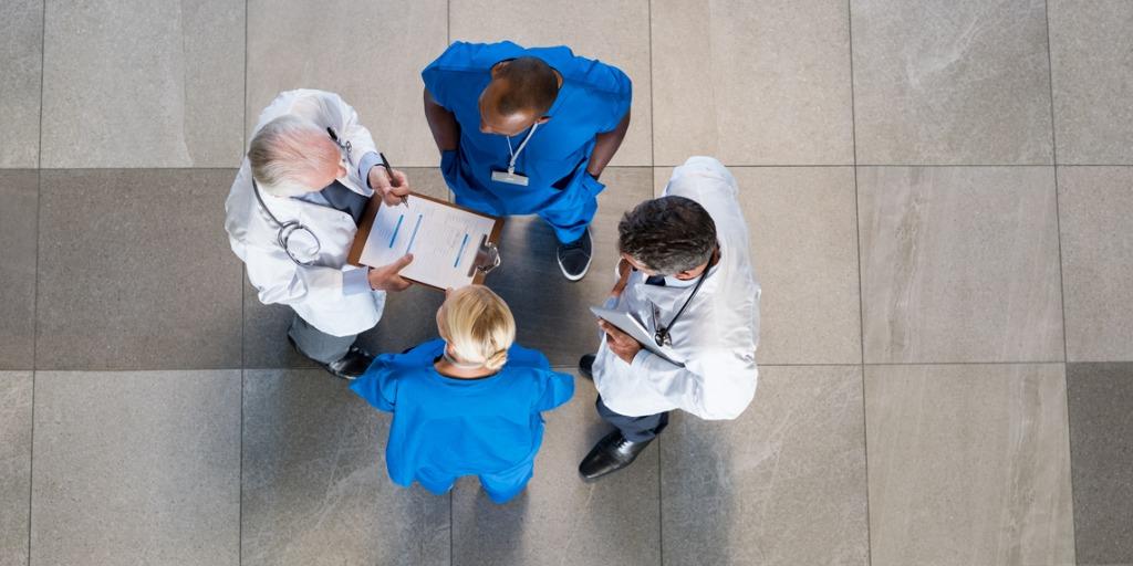 Doctors speaking in a hospital lobby