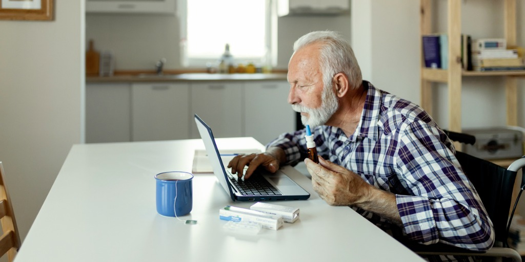 Senior man searching for information online about a treatment.