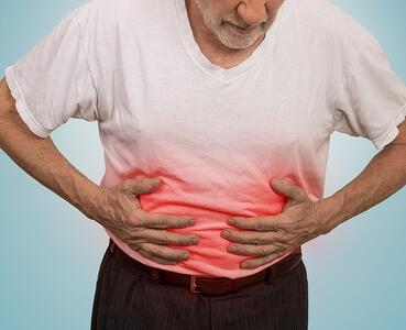 stomach-ache-man-placing-hands-on-the-abdomen-picture-id483922362