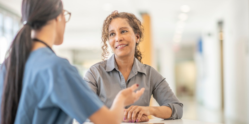 A female doctor is meeting with her female patient.